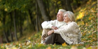 Senior couple sitting in a colourful park