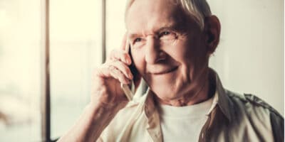 An older man speaking on a mobile phone